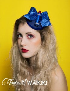 Fabulous navy blue lipstick fascinator. This a navy blue felt fascinator base, edged in velvet ribbon, decorated with a red lipstick and blue glitter ribbon. Attaches with a comb and adjustable hat elastic. This fascinator is perfect for a lady who loves 1950's pin up fashion or a rock & roll bride. It's the sort of headpiece you could really wear often as it's not too big or flamboyant but still guaranteed to be admired by many. It really is a must have headpiece just like red lipstick!