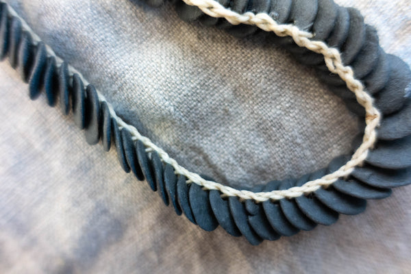Woven necklace disc