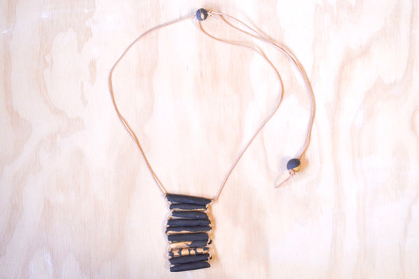 Woven necklace long black and gold