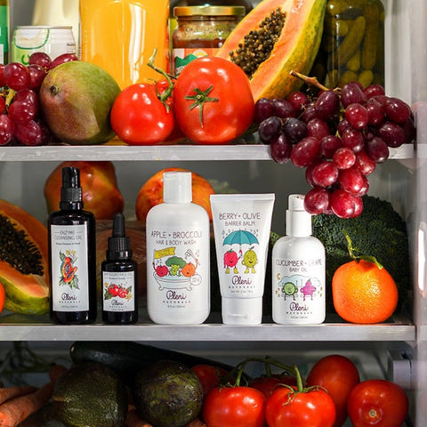about pleni naturals skin care collection for women and children with an abundance of fruits and vegetables like broccoli, papaya, tomato, cucumber, carrot