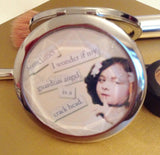 CheekyDoodah Compact Mirror with text 'Sometimes I Wonder If My Guardian Angel is a Crackhead'