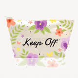 Personalised Floral Canvas Cosmetic Bag. Front reads 'NAME's Make-Up'. Back reads: 'Keep Off'