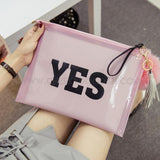PVC clutch printed with letters YES in Pink