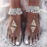 Sexy silver anklet chain on models feet on beach 2