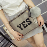 PVC clutch printed with letters YES in Pewter