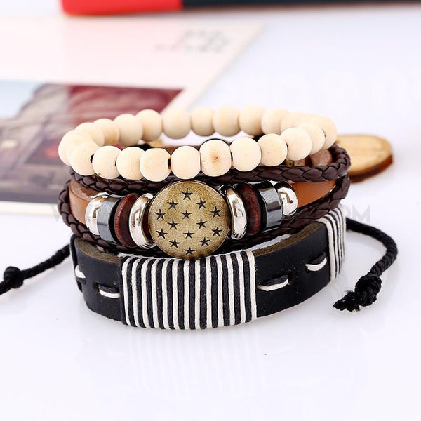 Mens 3 piece leather wood and bead bracelet set on counter