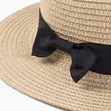CheekyDoodah Casual Chic Lady Boater Straw Sun Hats, with Stripe Ribbon or Black Bow design.  Chapel Feminine.  Wheat colour with black bow closeup