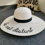 CheekyDoodah Fun n Flirty big, wide brimmed, straw sunhats for the fabulous woman, embroidered with letters 'do not disturb'.  Hat is foldable.   Material: Straw. Colour White