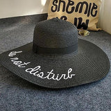 CheekyDoodah Fun n Flirty big, wide brimmed, straw sunhats for the fabulous woman, embroidered with letters 'do not disturb'.  Hat is foldable.   Material: Straw. Colour Black