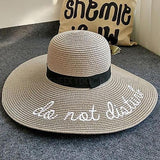 CheekyDoodah Fun n Flirty big, wide brimmed, straw sunhats for the fabulous woman, embroidered with letters 'do not disturb'.  Hat is foldable.   Material: Straw. Colour Grey
