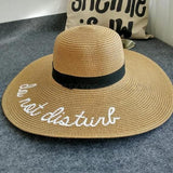 CheekyDoodah Fun n Flirty big, wide brimmed, straw sunhats for the fabulous woman, embroidered with letters 'do not disturb'.  Hat is foldable.   Material: Straw. Colour Khaki