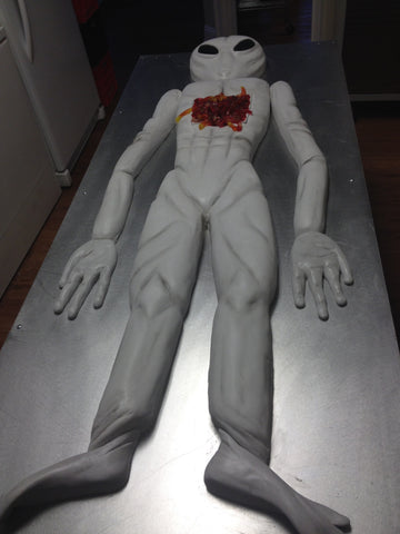 6 Foot Sculpted Alien Autopsy Cake with Raspberry Compote