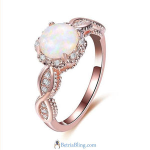 32868834305 - Rainbow Opal Engagement Ring