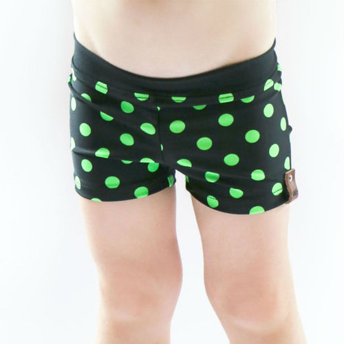 Euro swim shorts unisex for kids by Mini Street in black lime polka dots