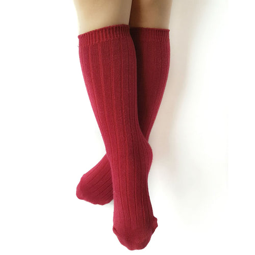 Red knee length tall socks for modern kids.  Unisex.