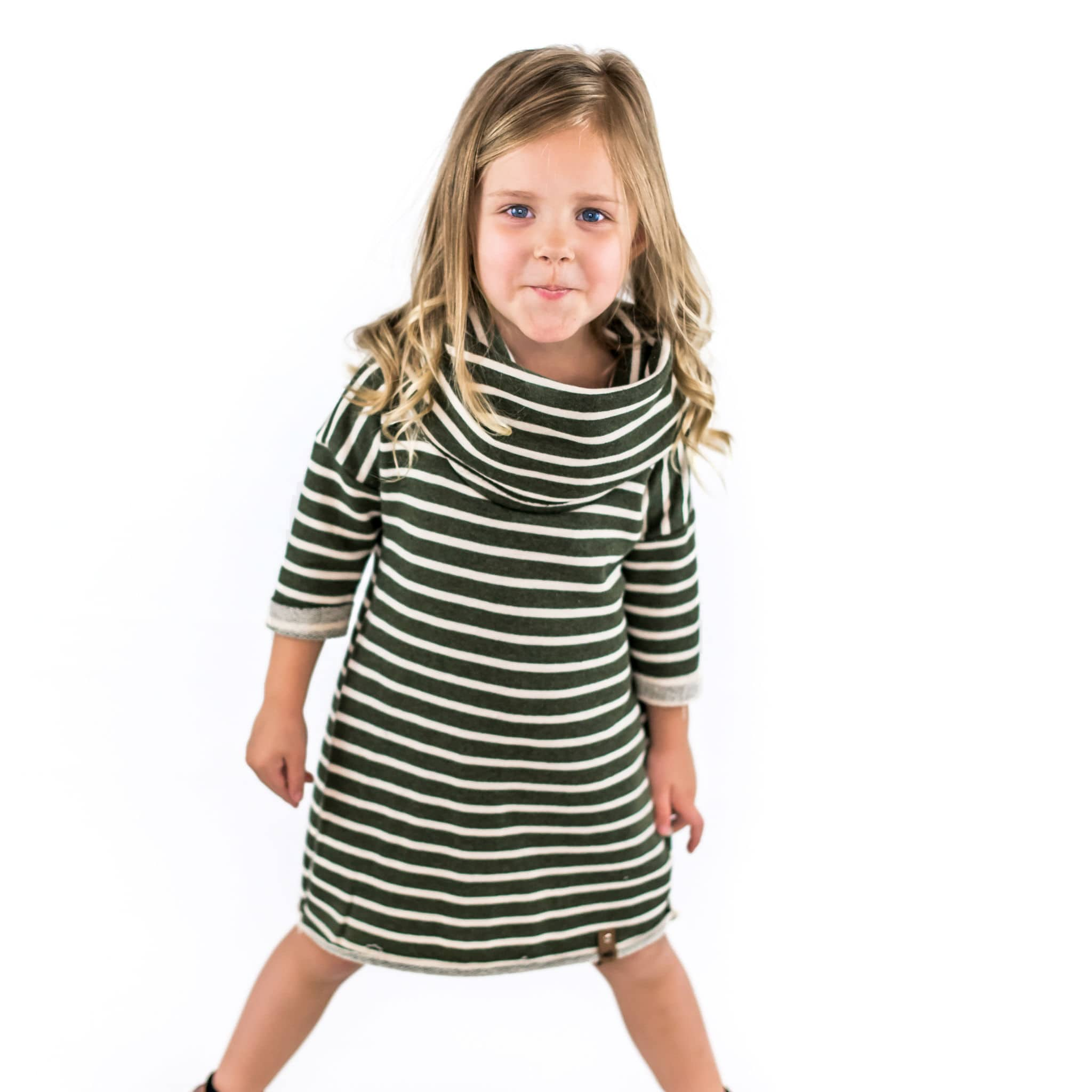 Little girl wearing olive stripe dress with cowl by Mini Street