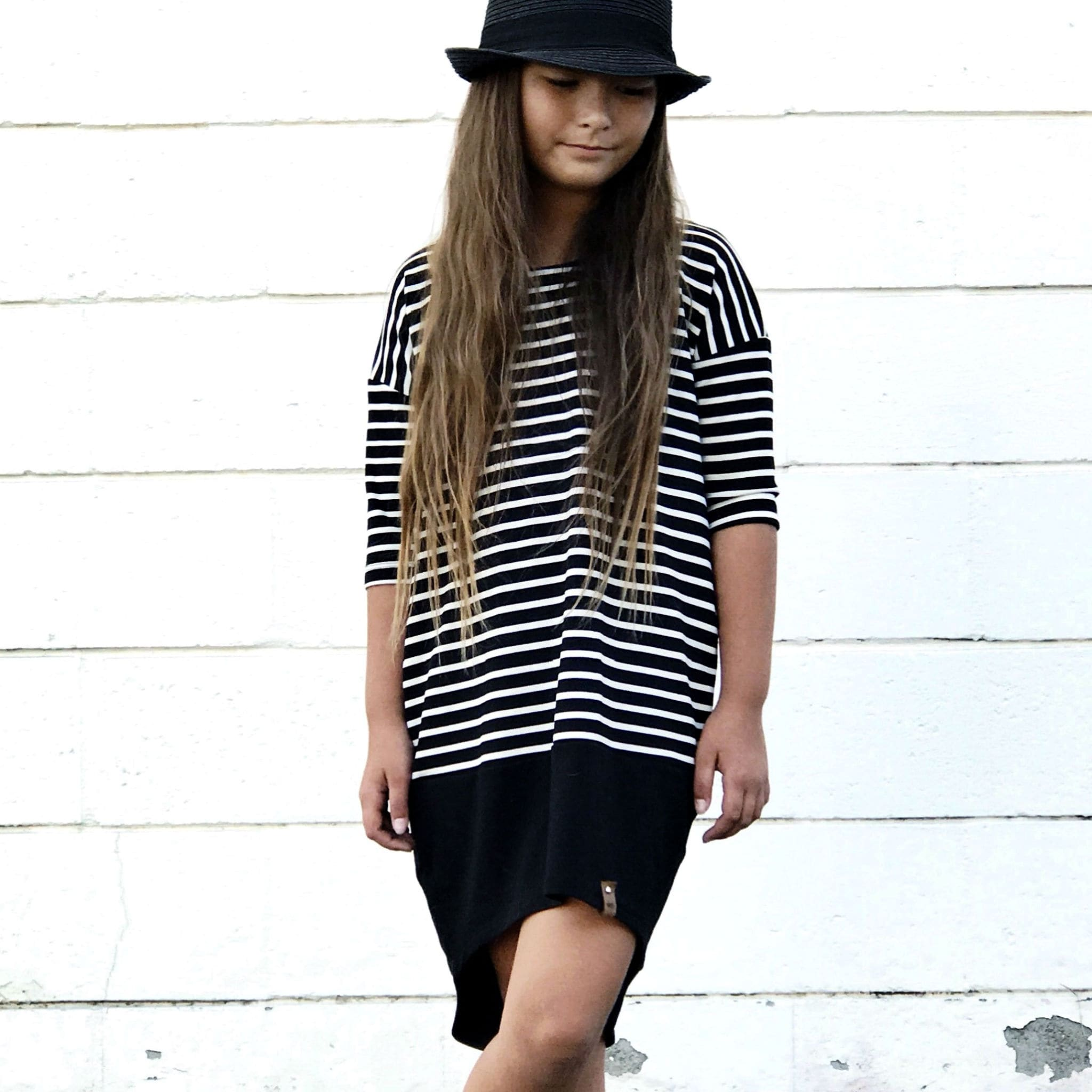 Stylish girl in monochrome striped dress by Mini Street
