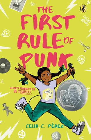 Text reads The First Rule of Punk by Celia C. Pérez, tagline reading Always remember to be yourself.. Image shows a young girl in a Blondie tshirt in mid-jump, holding a microphone in one hand. Background is bright yellow-green, with lightning bolts, skulls, records, a voo doo doll decorating the edges. Book has a silver Pura Belpré Author Honor Book medal printed on the cover.