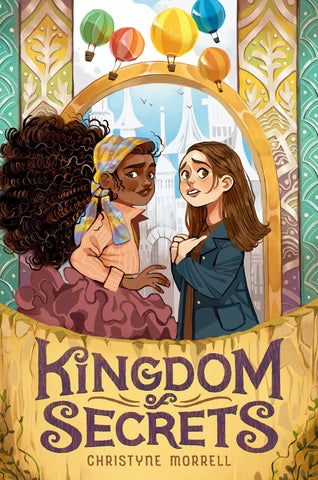 Text reads Kingdom of Secrets by Christyne Morrell. Cover shows a young Black girl with natural brown hair wearing a scarf and a young white girl with straight brown hair wearing a jacket staring into the camera. Girls are framed by a golden arch and colourful, patterned pillars. Colourful hot air balloons float above their heads.