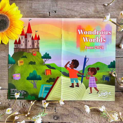 Magazine reads Wondrous Worlds June 2021. Image shows two young Black children starring off towards a castle in the distance. Magazine is surrounded by flowers.