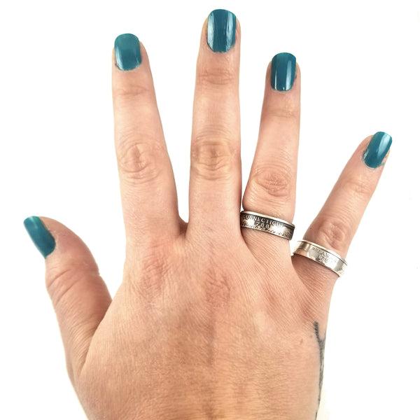 silver quarter rings on hand by midnight jo