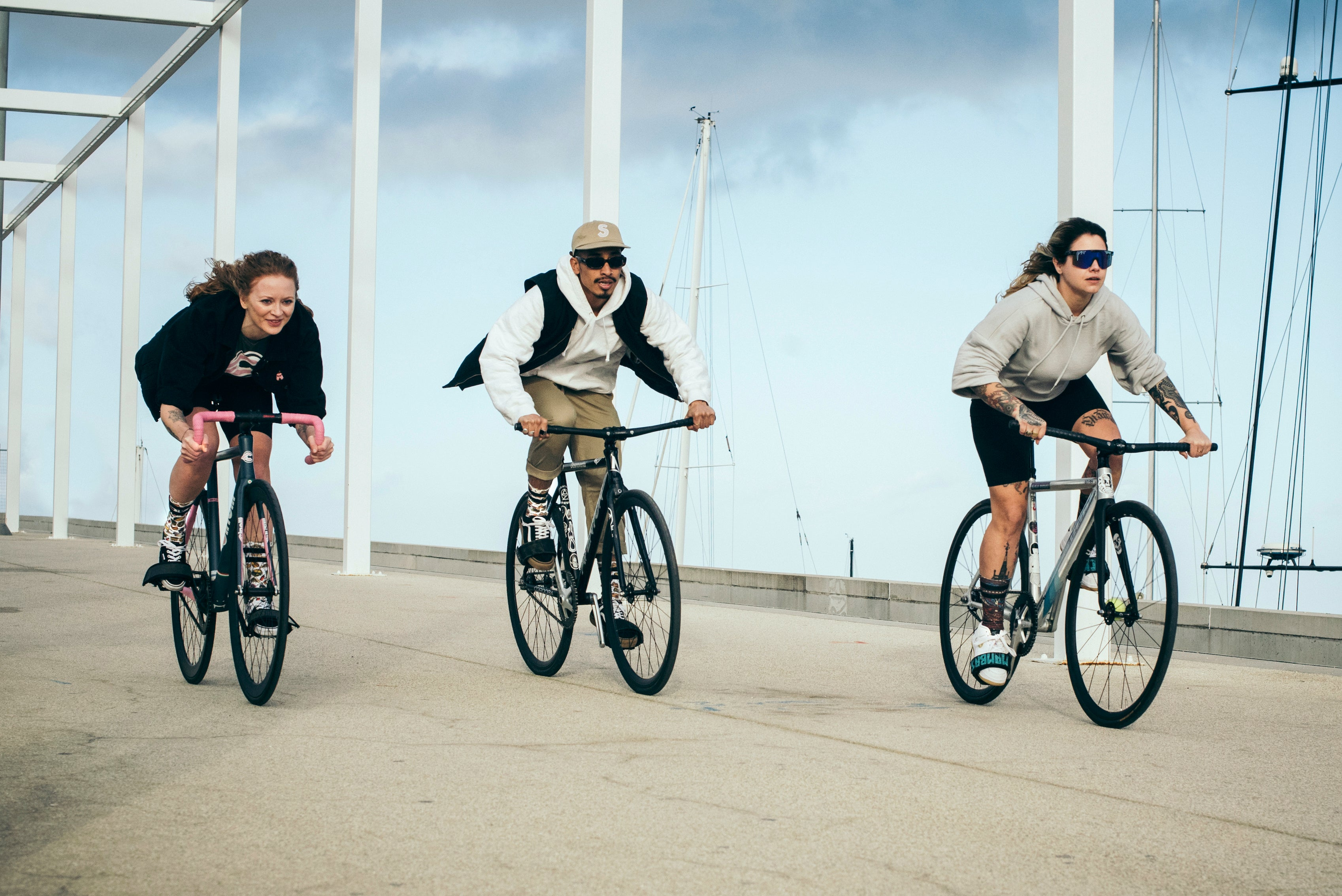two girls and one guy riding their bikes
