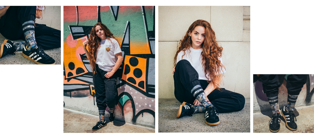 three images of a model wearing the conspiracy socks against a grafiti wall