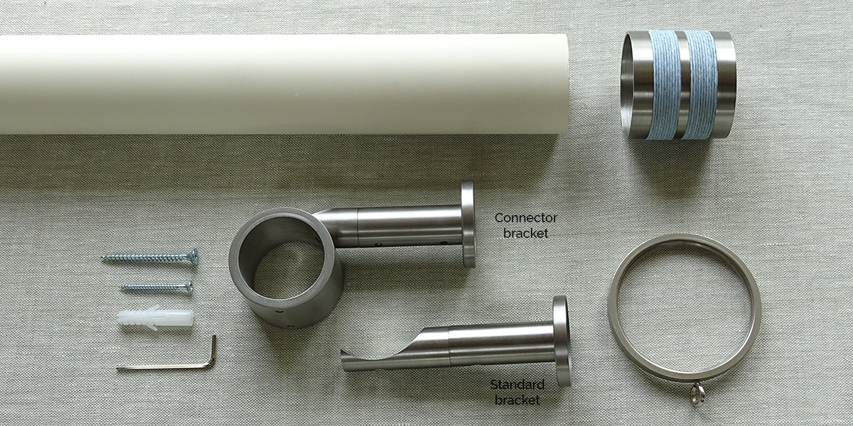 What's included 50mm dia. matt lacquered soft white curtain pole set with bobbin finials