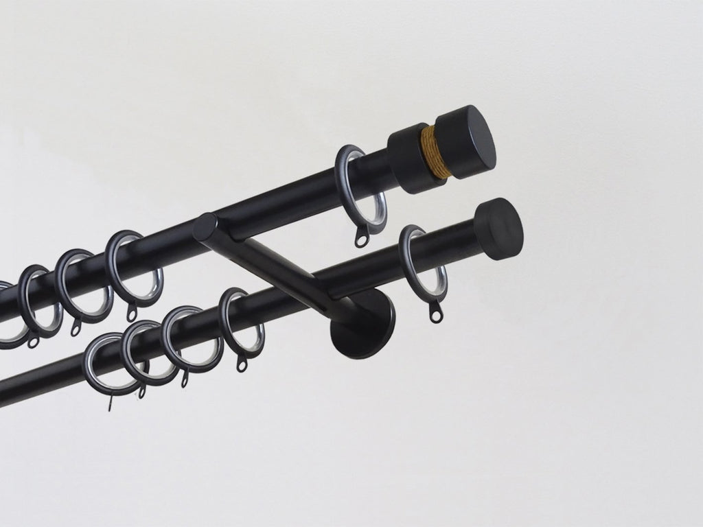 Walcot House | Designer black metal double curtain pole set with decorative groove finials and old gold coloured twine inserts
