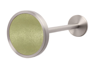 Silver metal curtain hold back in grass dew green