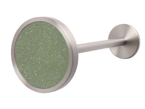 Silver metal curtain hold back in sage green