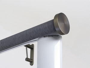 Motorised electric curtain pole in flint blue, wireless & battery powered using the Somfy Glydea track | Walcot House UK curtain pole specialists