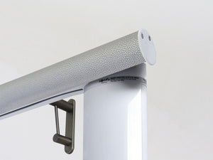 Motorised electric curtain pole in pebble grey, wireless & battery powered using the Somfy Glydea track | Walcot House UK curtain pole specialists