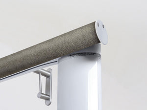 Motorised electric curtain pole in purbeck bronze, wireless & battery powered using the Somfy Glydea track | Walcot House UK curtain pole specialists