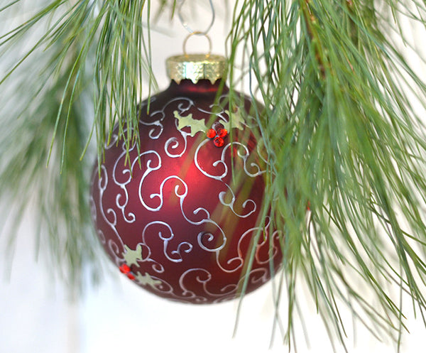 hand painted red Victorian Christmas ornament with holly