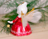 Real feathers and metallic gold wings on Christmas angel bell