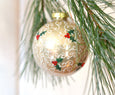 Light gold Victorian Christmas ornament with holly