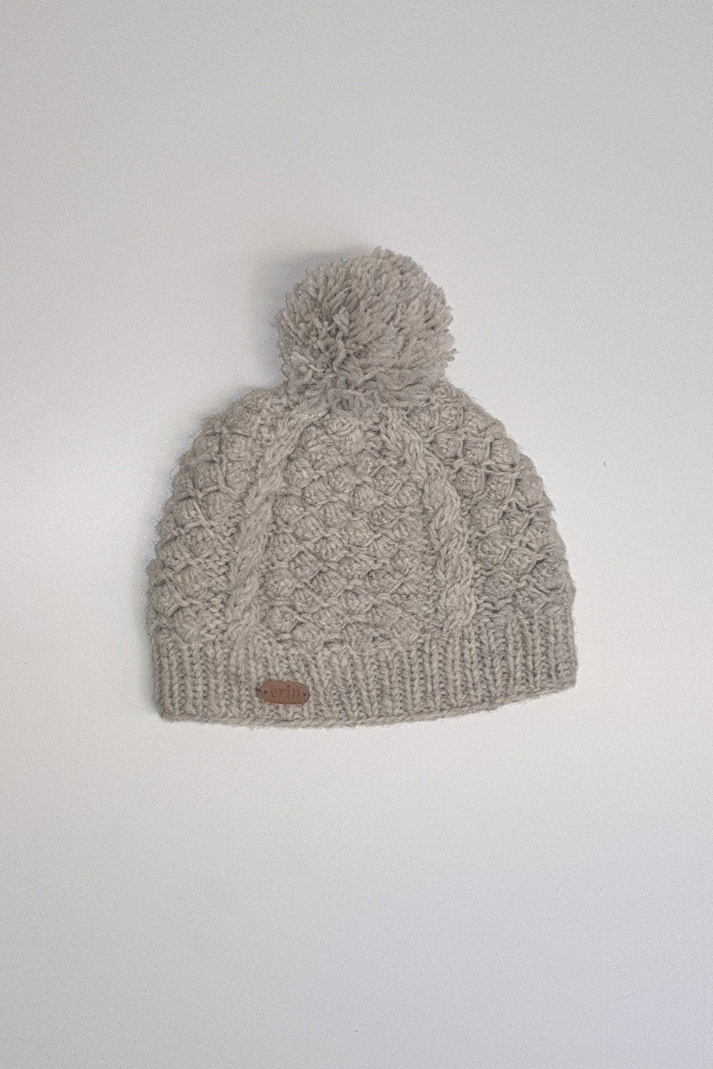 9077090ff96 Erin Irish Wool Bobble Hat - Blackberry Oatmeal