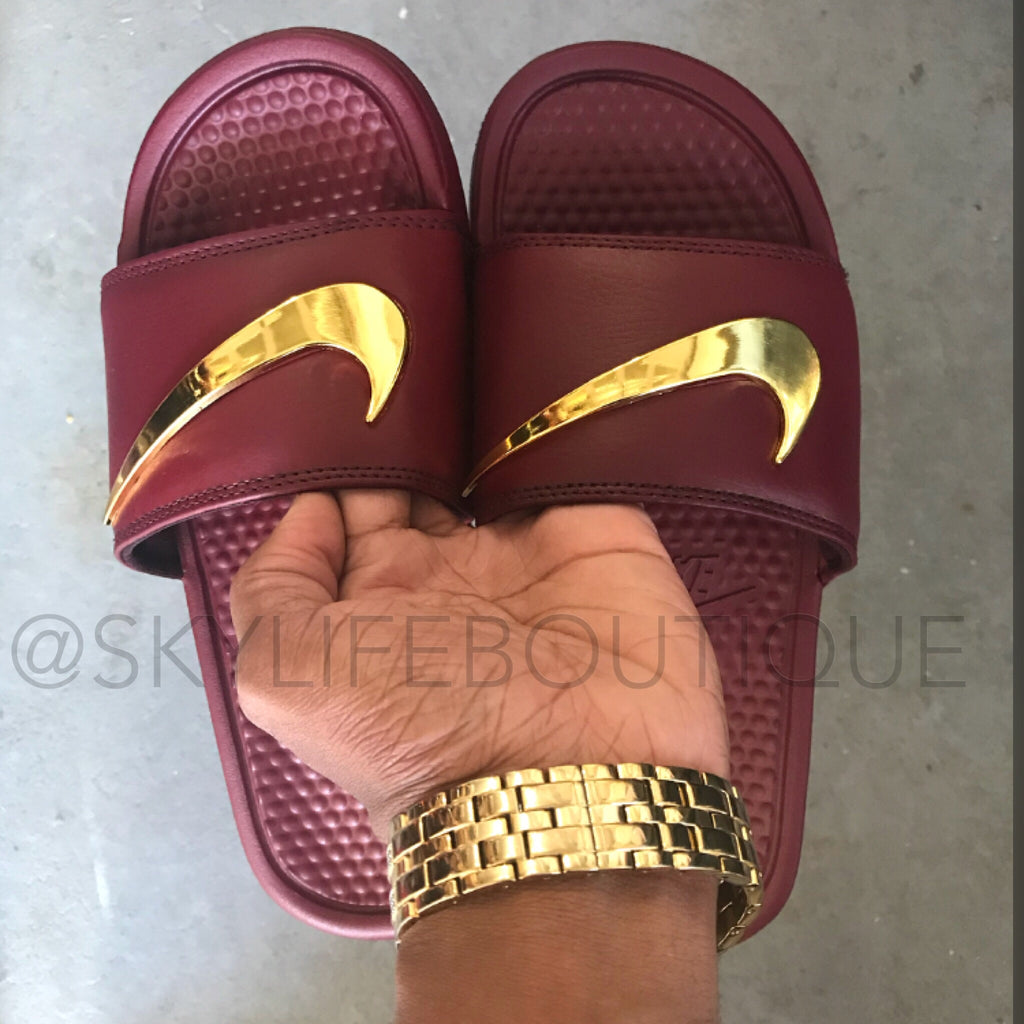 burgundy nike sandals with gold