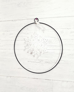 give JOY snowflake in large metal circle - Barrett Renovation & Home