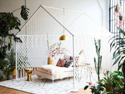 Macrame tent living room.