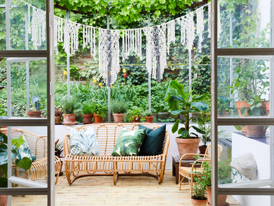 Macrame garland in a glass greenhouse