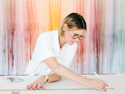 Nike Schroeder artist in Los Angeles with her colorful string art