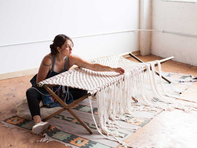 Interested in learning macrame? Learn with Emily Katz featured here making a macrame cot.