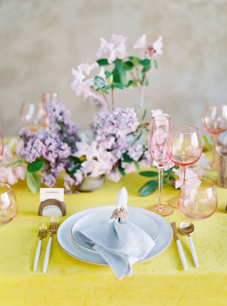 Wedding pop of color, delicate place setting with lavender florals and macramé