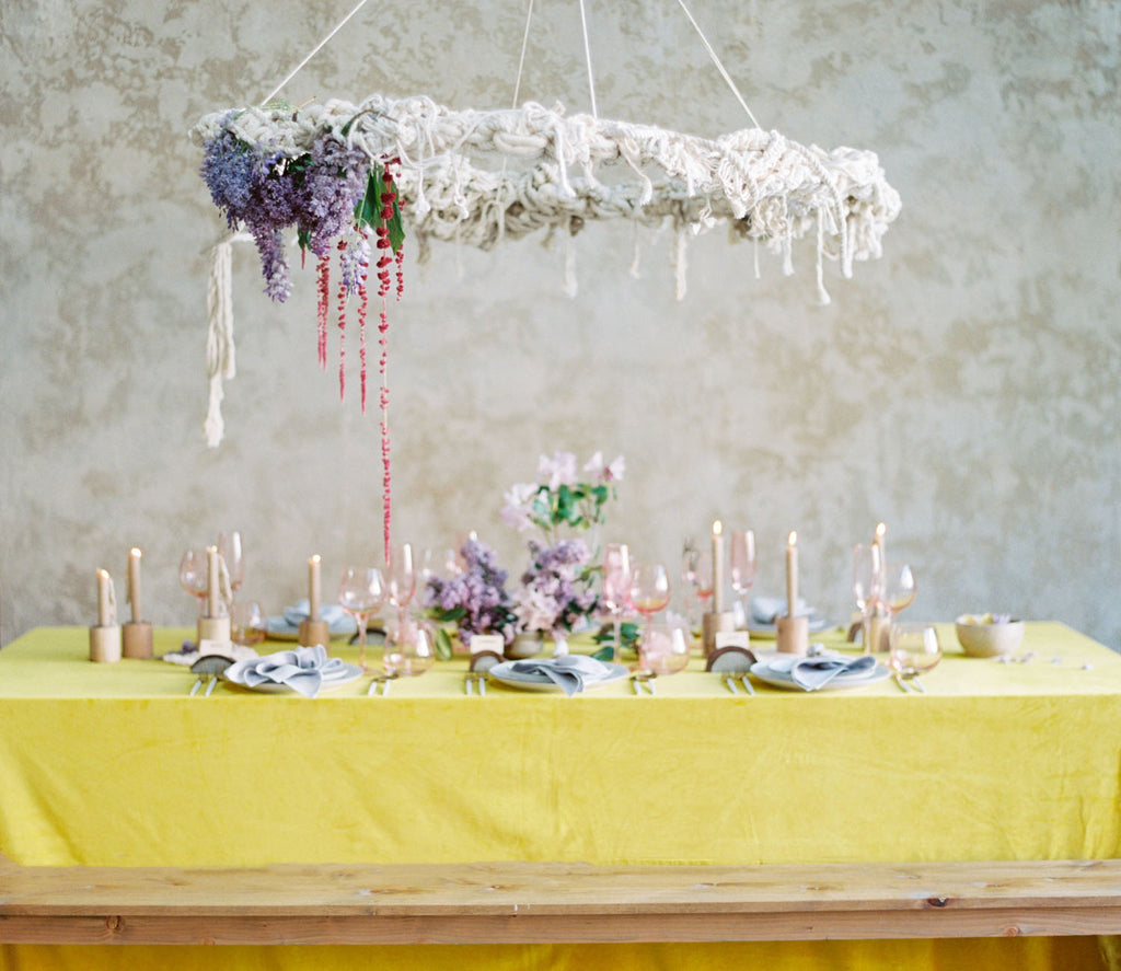 Whimsical macramé wedding table setting with a pop of color
