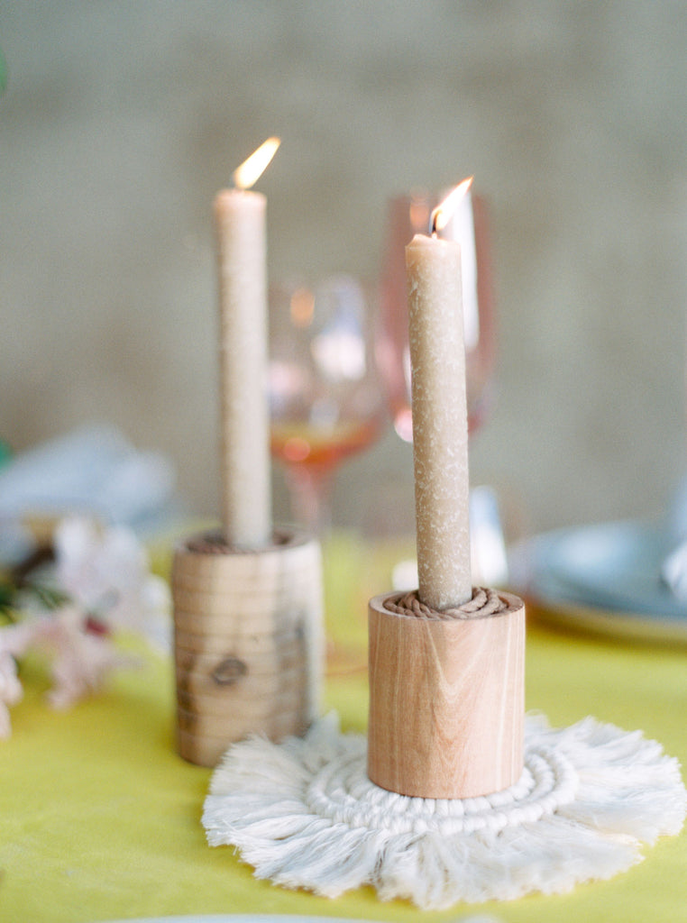 Wedding table settings for an inspired, ethereal macramé wedding with candle sticks