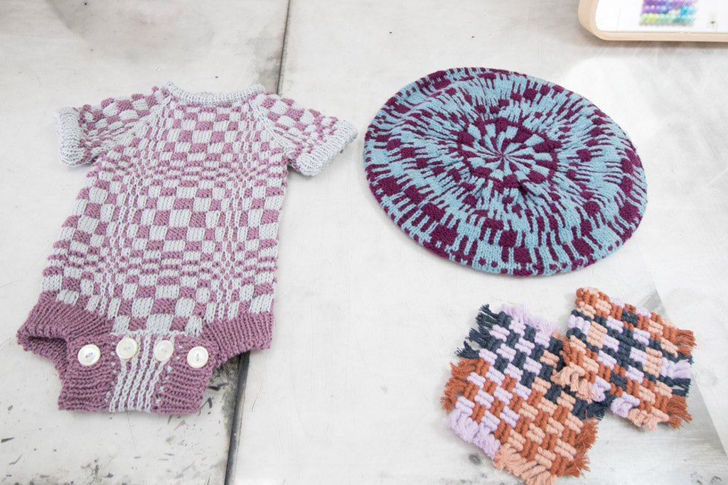 Knitted goods by Elspeth Vance featuring an optical checkerboard pattern