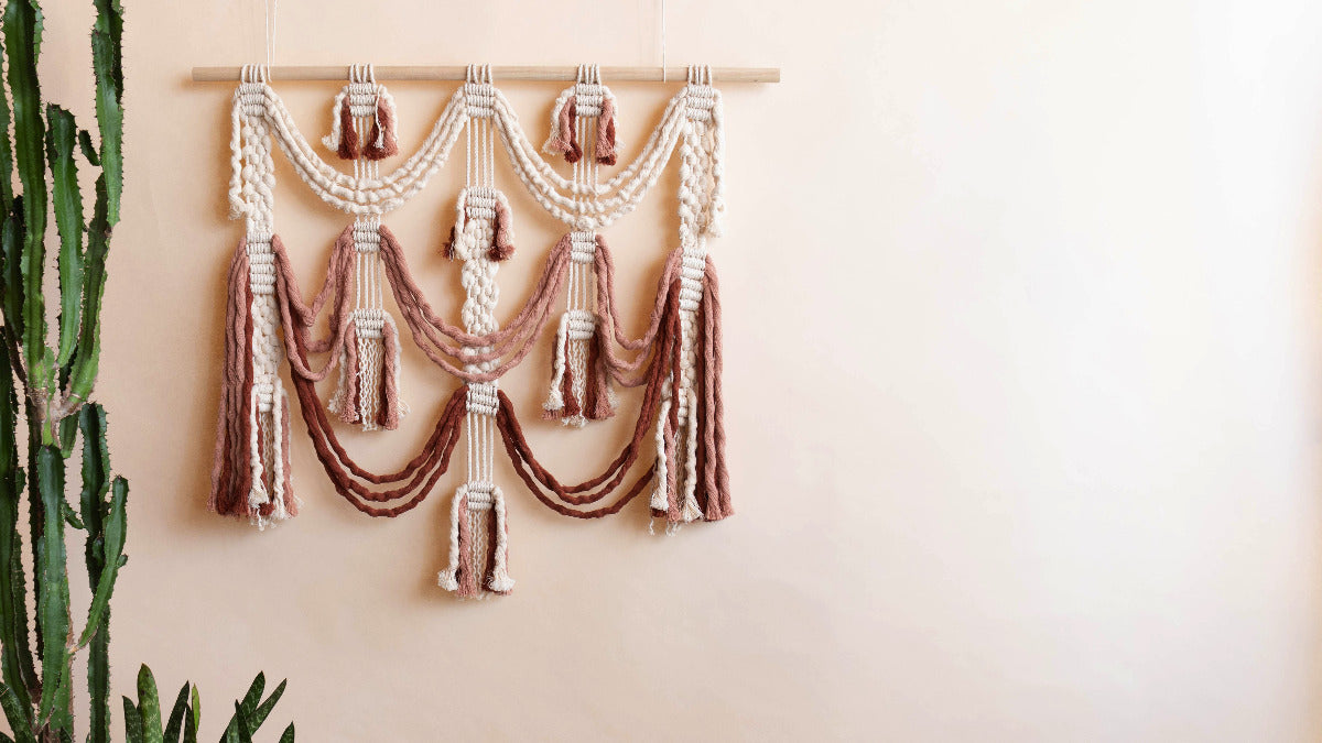cactus and rust, natural, and peach rope and cord macrame wall hanging