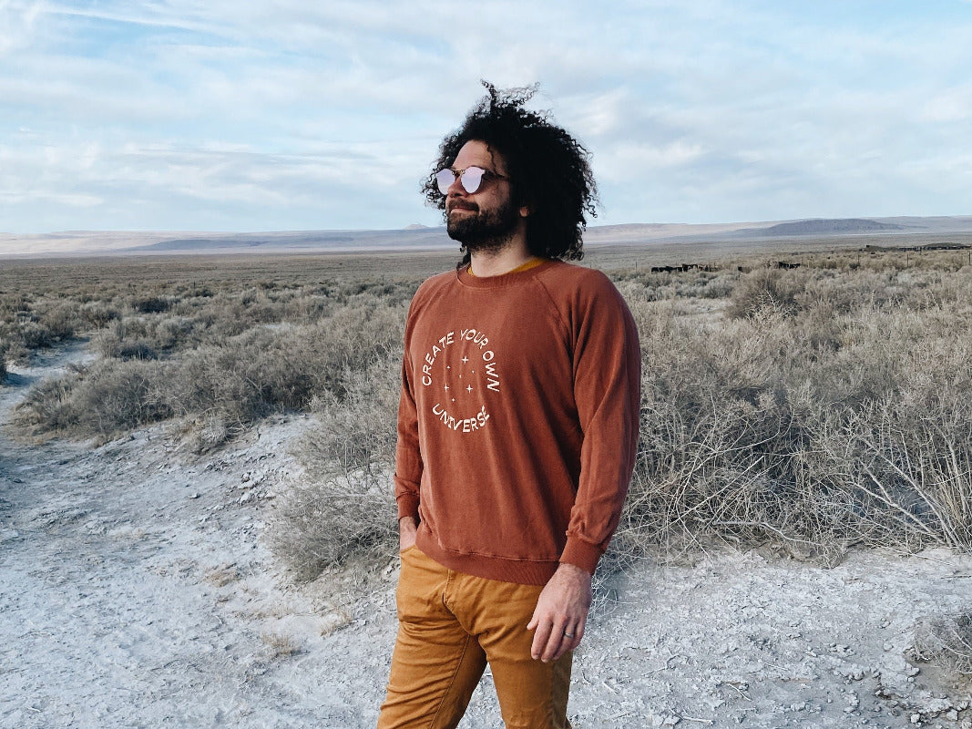 Adam Porterfield wearing our unisex sweatshirt, Create Your Own Universe, Jungmaven in Extra Large
